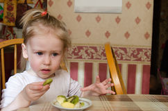 Girl and kiwi Stock Photography