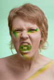 Girl with kiwi make-up Royalty Free Stock Photo