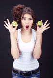 Girl with kiwi. Royalty Free Stock Image