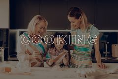 Girl Knead Dough. Happy Family Enjoy Cooking. Woman Search Recipes. Grandmother Help Girl. Happy Family Cooking. Little Girl Prepare Dough. Child Make Cookies stock images