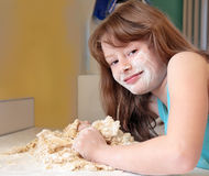 Girl Kneading Bread Dough Royalty Free Stock Photo