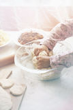 Girl kneads dough Royalty Free Stock Images
