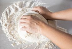 Closeup of girl kneads dough royalty free stock photo