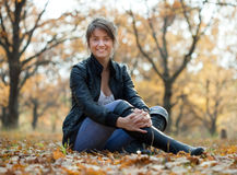 Girl in  knee-high boots at autumn. Girl in jacket and knee-high boots at autumn park Stock Photography