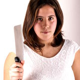 Girl with knife Stock Image