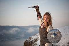 Girl knight. Girl in armor with a sword knight Stock Images