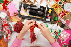 Girl knit doll clothes, top view, sewing accessories top view, seamstress workplace, many object for needlework, handmade and hand Stock Photo