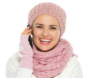 Girl in knit winter clothing making phone call Stock Images