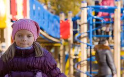 Girl in knitted cap against autumn park Royalty Free Stock Image