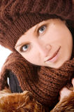 The Girl in a knitted cap smiles Royalty Free Stock Photo
