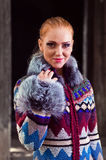 Girl in a knitted coat Royalty Free Stock Photo