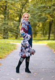 Girl in a knitted coat Royalty Free Stock Images