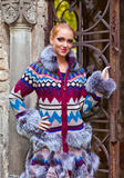 Girl in a knitted coat Stock Images