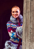 Girl in a knitted coat Stock Photography