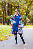 Girl in a knitted coat Royalty Free Stock Image