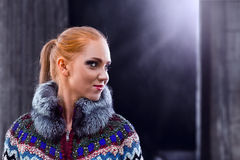 Girl in a knitted coat Stock Photos