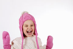 Girl in a knitted hat and mittens. Pretty adorable charming little girl in a knitted hat and a mittens. sHe is smiling laughs and looking up. close-up portrait stock photography