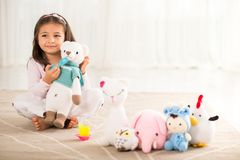 Girl with knitted toys Stock Image