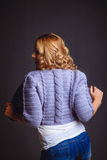 Girl in a knitted violet cardigan Stock Image