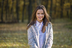 Girl in an knitted warm jacket. Royalty Free Stock Photo