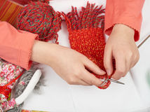 Girl knitting a scarf, top view, sewing accessories top view, seamstress workplace, many object for needlework, handmade and handi Stock Photography