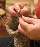 Girl knitting sock. A woman binds on spokes toe from wool stock image
