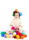 Girl with knitting spokes and balls of threads in hair Royalty Free Stock Images