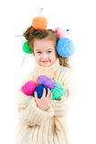 Girl with knitting spokes and balls of threads in hair Stock Photography