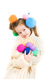 Girl with knitting spokes and balls of threads in hair Stock Photos