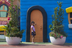 Girl knocking on door Stock Photo