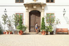 Girl knocking on door in palace Trebon Royalty Free Stock Images