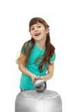 Girl knocks over big pot Royalty Free Stock Image
