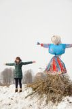 Girl with Kostroma or straw Lady Maslenitsa during winter Maslen Stock Photography