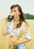 Girl  with kvass Royalty Free Stock Images