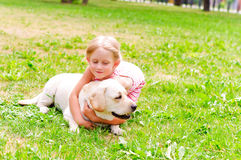 Girl and she labrador Stock Images