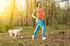 Girl with labrador in park. Girl with labrador for jog in park Royalty Free Stock Photo