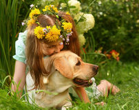 Girl and a labrador retriever. Stock Photos