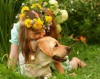 Girl and a labrador retriever. Stock Photos