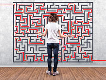Girl before a labyrinth Stock Images