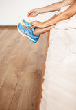Girl lace her run shoes sitting in bed at the morning Stock Photography