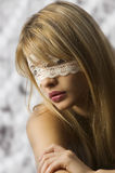 Girl with lace mask Stock Image