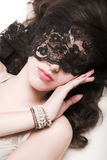 Girl with lace mask. Close up royalty free stock photo