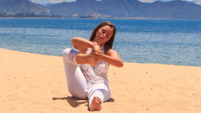 girl in lace shows yoga asana foot behind head and under breast stock video footage