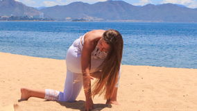 girl in lace shows yoga asana forward bend hand round leg stock video