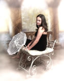 Girl with lace umbrella. A sepia toned portrait of a teenager in a fancy dress, holding a lace umbrella Stock Photos