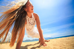Girl in lace wind shakes hair in yoga asana arms balance Stock Photography