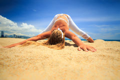 Girl in lace in yoga asana downward facing arms balance front Stock Photography