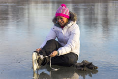 The girl in lace your skates on the ice. Royalty Free Stock Images
