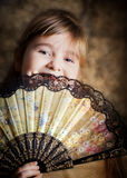 Girl with a lacy fan Royalty Free Stock Photography