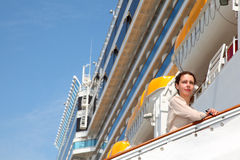 Girl on ladder goes to the ship Stock Photos